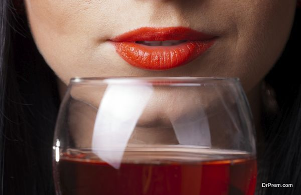 Red lips and glass of wine
