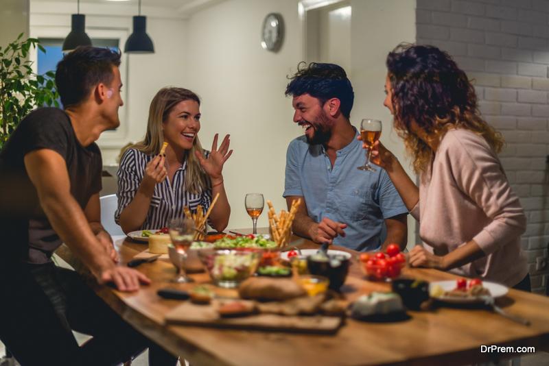 friends enjoying dinner party